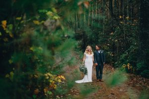 Bride and groom surrounded by greenery