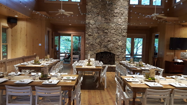 Stone fireplace and rustic dining room
