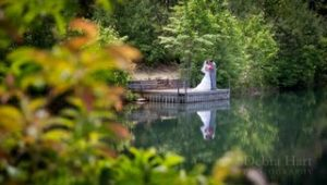 Long shot of couple embracing beside a lake