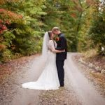 Bride and groom standing on a dirt road